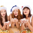 Three woman blow feather — Stock Photo #4594874