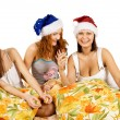 Three young woman play on pillows — Stock Photo