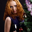 Young beauty red woman and christmas tree — Stock Photo