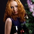 Young beauty red woman and christmas tree — Stock Photo #4595032