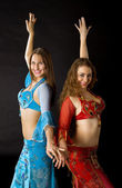 Two young woman dance and smile — Stock Photo