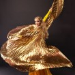 Beauty woman dance with gold wing - Foto Stock