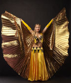 Beauty woman dance with gold wing — Stock Photo