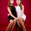 Two sisters in black and white dress — Stock Photo