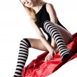 Young beauty girl with naked buttocks and striped socks — Stock Photo