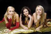 Three young woman on gold wing — Stock Photo