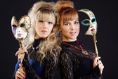 Two beauty sisters with mask — Stockfoto