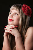 Happy Blond With Red Flower in hair — Stock Photo