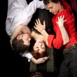Red woman in mask and two men - love triangle — Stock Photo