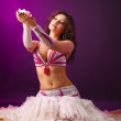 Beauty woman in ballet costume with rose candle — Stock Photo