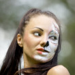 Woman with tigress face art portrait — Stock Photo