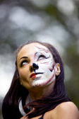 Woman with tigress face art — Stock Photo