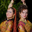 Two young woman dance - indian cloth — Stock Photo