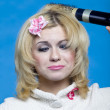 Funny blond with hairdryer — Stock Photo #4821669