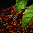 Coffee beans and green leaf — Stock Photo