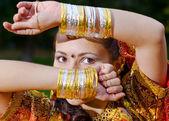 A young Indian woman hiding face — Stock Photo