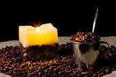Cup wtih coffee bean and candle — Stock Photo