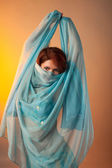 Woman in arabian costume hide face with veil — Stock Photo