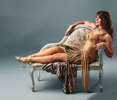 Arabian dancer relax on old-styled chair — Stock Photo