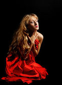 Blond woman in red - painfull emotions — Stock Photo