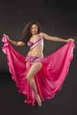 Beauty woman dance in rose arabian costume — Stock Photo