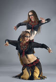 Two woman dance in warrior cosutme — Stock Photo