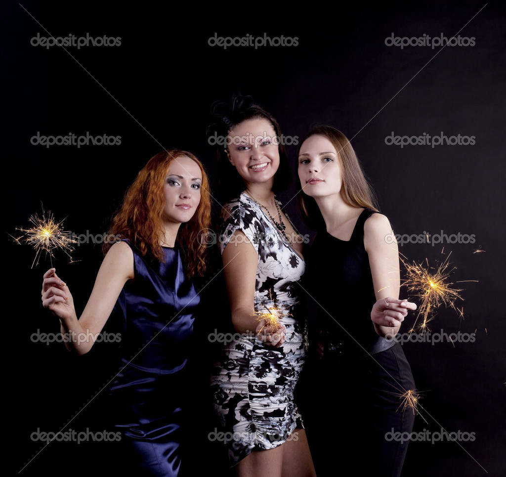 Three young woman smile with bengal light  Stock Photo #5163750