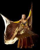 Blond woman dance with gold wing — Stock Photo