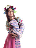 Beauty girl with garland posing in russian costume — Stock Photo