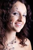 Woman face with paint close-up portrait — Stock Photo