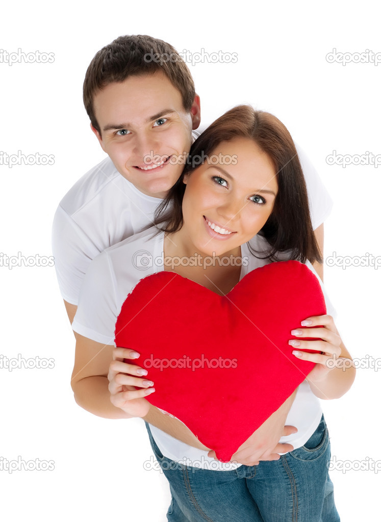 Couple with a red heart on white background — Stock Photo #4732298