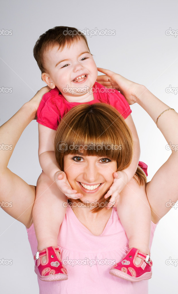 Happy mother with a baby on a white background  Stock Photo #4927381