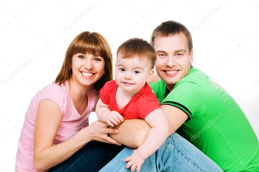 Happy family with a baby on a white background — Stock Photo #4927408