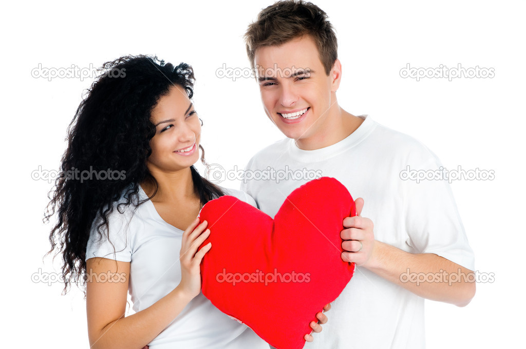Beautiful young couple holding a red heart — Stock Photo #4941451