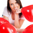 Young brunette with red hearts isolated - Stockfoto