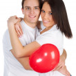 Couple with a red heart — Stock Photo