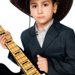Boy in a cowboy hat and guitar - Stock Photo