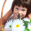 Beautiful little girl with flowers - Stock Photo