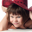 Beautiful little girl in a red hat - Stock Photo