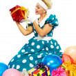 Stock Photo: Young woman with colorful gifts