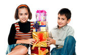 Choldren with gifts — Stock Photo
