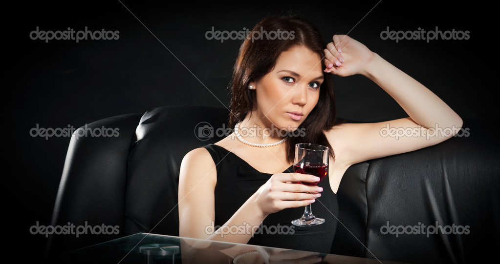Beautiful brunette with a glass of red wine — Stock Photo #5033620