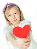 Cute little girl with red heart — Stock Photo