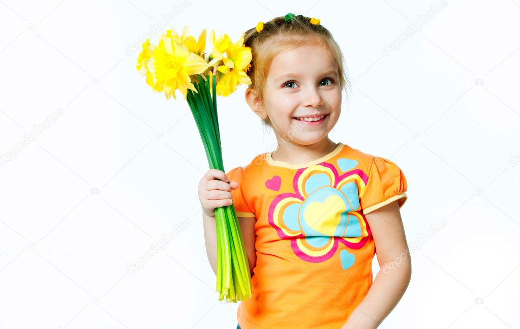 Beautiful little girl with a bouquet of daffodils — Stock Photo #5357984