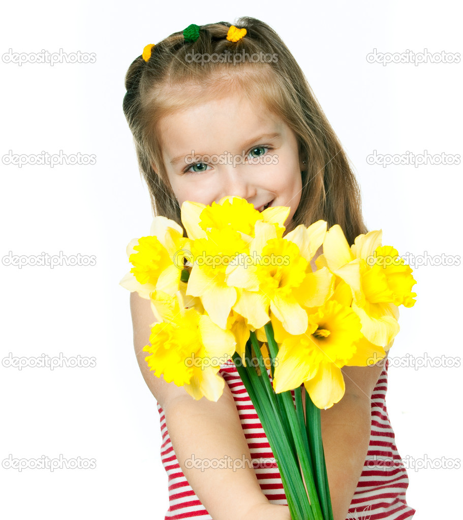 Beautiful little girl with a bouquet of daffodils — Stock Photo #5357989