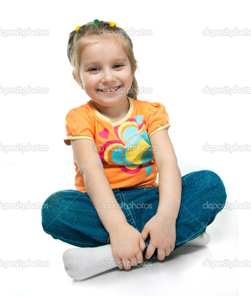 Beautiful little girl smiling on a white background — Stock Photo #5358073