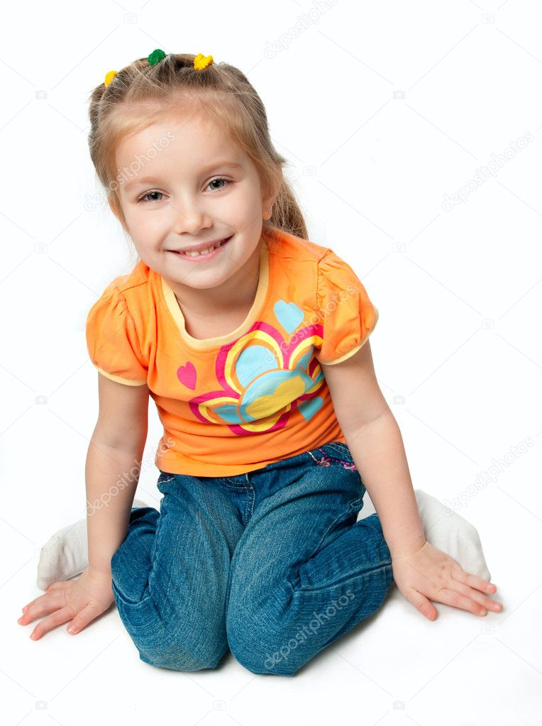 Beautiful little girl smiling on a white background — Stock Photo #5358078