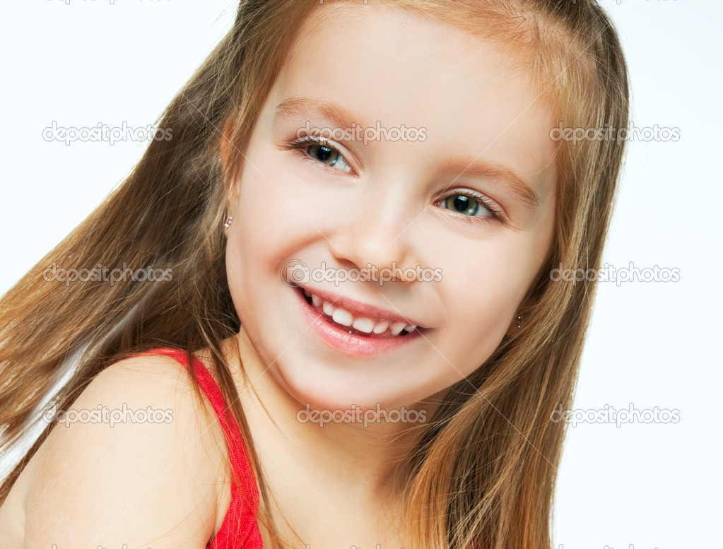 Beautiful little girl smiling on a white background — Stock Photo #5358081