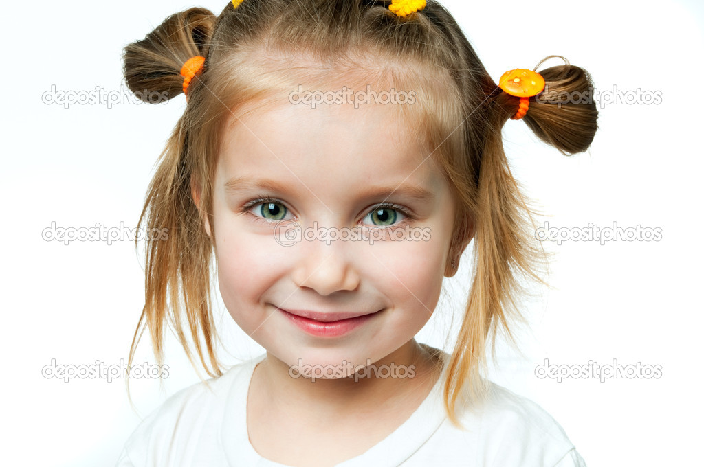 Beautiful little girl smiling on a white background — Foto de Stock   #5358086