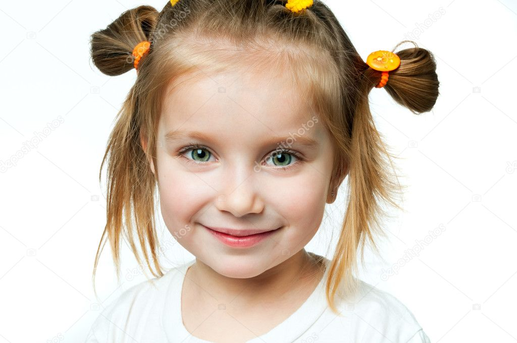 Beautiful little girl smiling on a white background — Stock fotografie #5358086